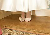 Bride's shoes and vinatage style wedding  dress before her wedding at the Mustard Seed Restaurant, Ballingarry, Co. Limerick