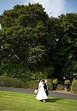 Wedding couple on a romantic walk at the Mustard Seed, Ballingarry, Co. Limerick