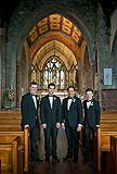 Groom with his groomsmen at the Holy Trinity Church in Adare, Co. Limerick, Ireland.