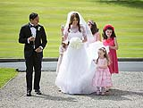 Children helping the bride with her dresss at her wedding at Adare Manor, Adare, Co. Limerick, Ireland.