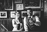 Newly married couple enjoying a couple of pints of guinness, at O'Donohue's pub in the Burren, Co. Clare, on the west coast of Ireland.