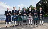 Groom with his guests showing off their colourful kilts at a wedding at AnnaCarriga Killaloe, Co. Clare, Ireland.