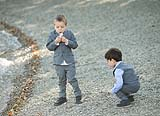 Two little boys having fun during a wedding at AnnaCarriga Killaloe, Co. Clare, Ireland.