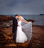 Emma O'Driscoll and her groom Liam braving the weather after their wedding at Spiddal Church, Co.Galway.