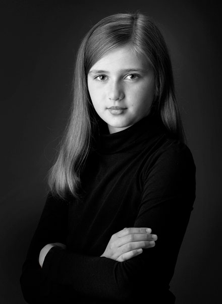 Portrait of beautiful young girl in classic timeless style.