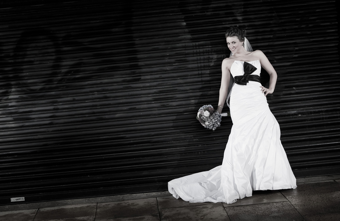 The bride posing for a photo before her wedding reception in the Strand Hotel, Limerick