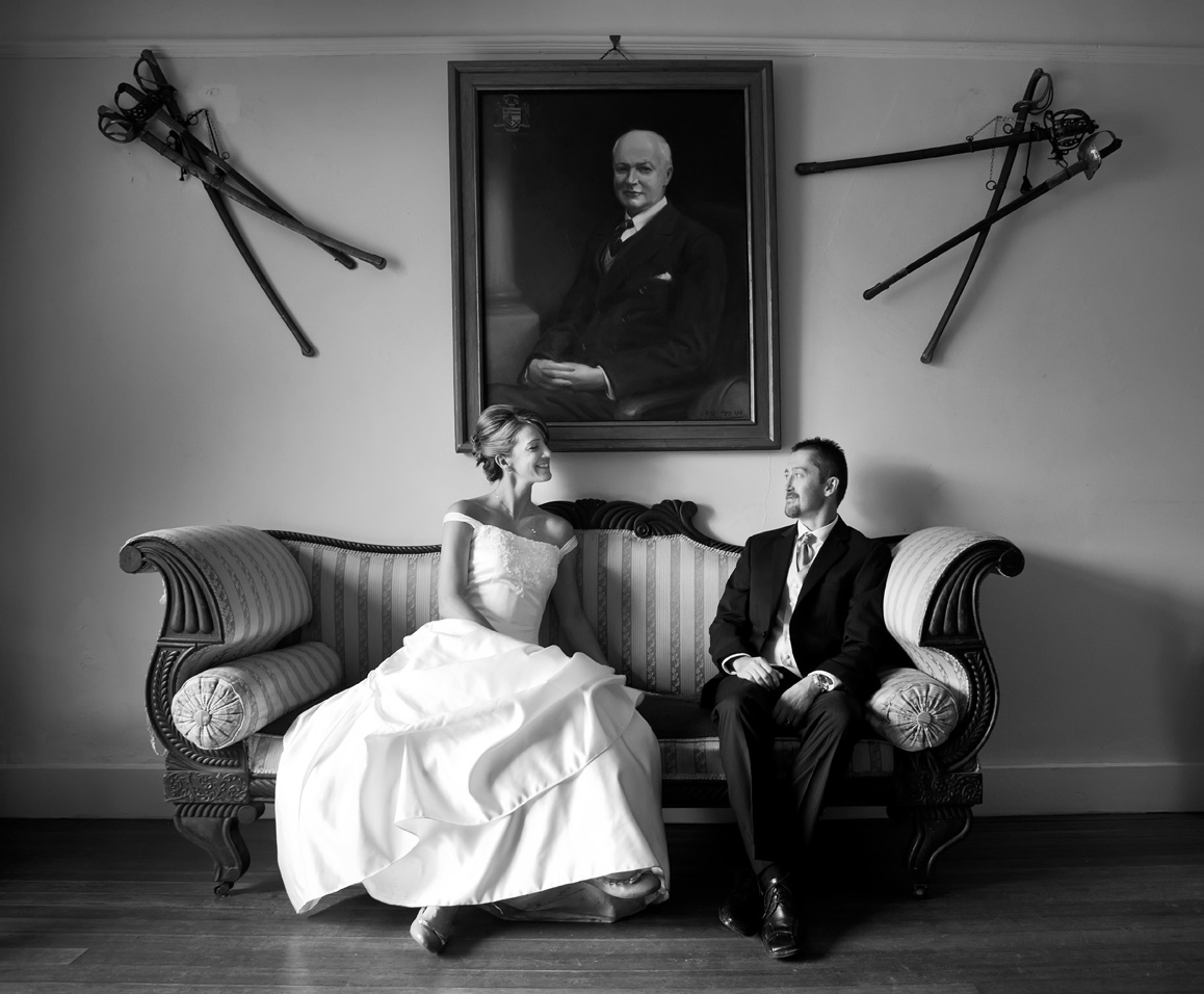 The couple pose for a photograph on a sofa in Springfield Hall, Broadford, Co. Limerick
