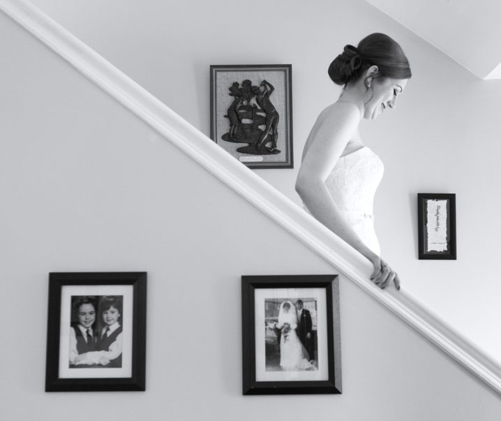 Bride walking down stairs before her wedding in St. Mary's Church, Corbally, Limerick