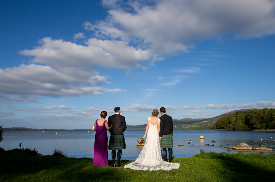 Bridal party enjoying the fabulous view at a lake near Killaloe, Co. Clare, Ireland.