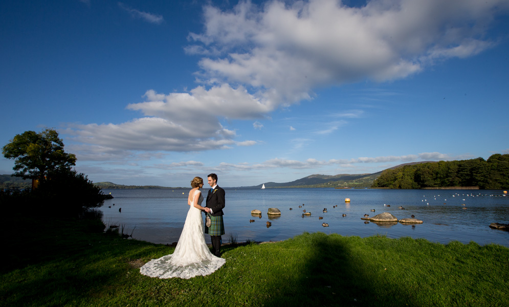 Wedding couple enjoying the fabulous view at a lake near Killaloe, Co. Clare, Ireland.