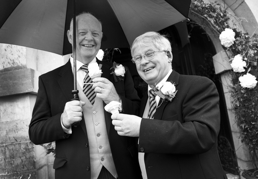 Fathers of bride and groom enjoying icecreams at a wedding in Spiddal Church, Co. Galway.